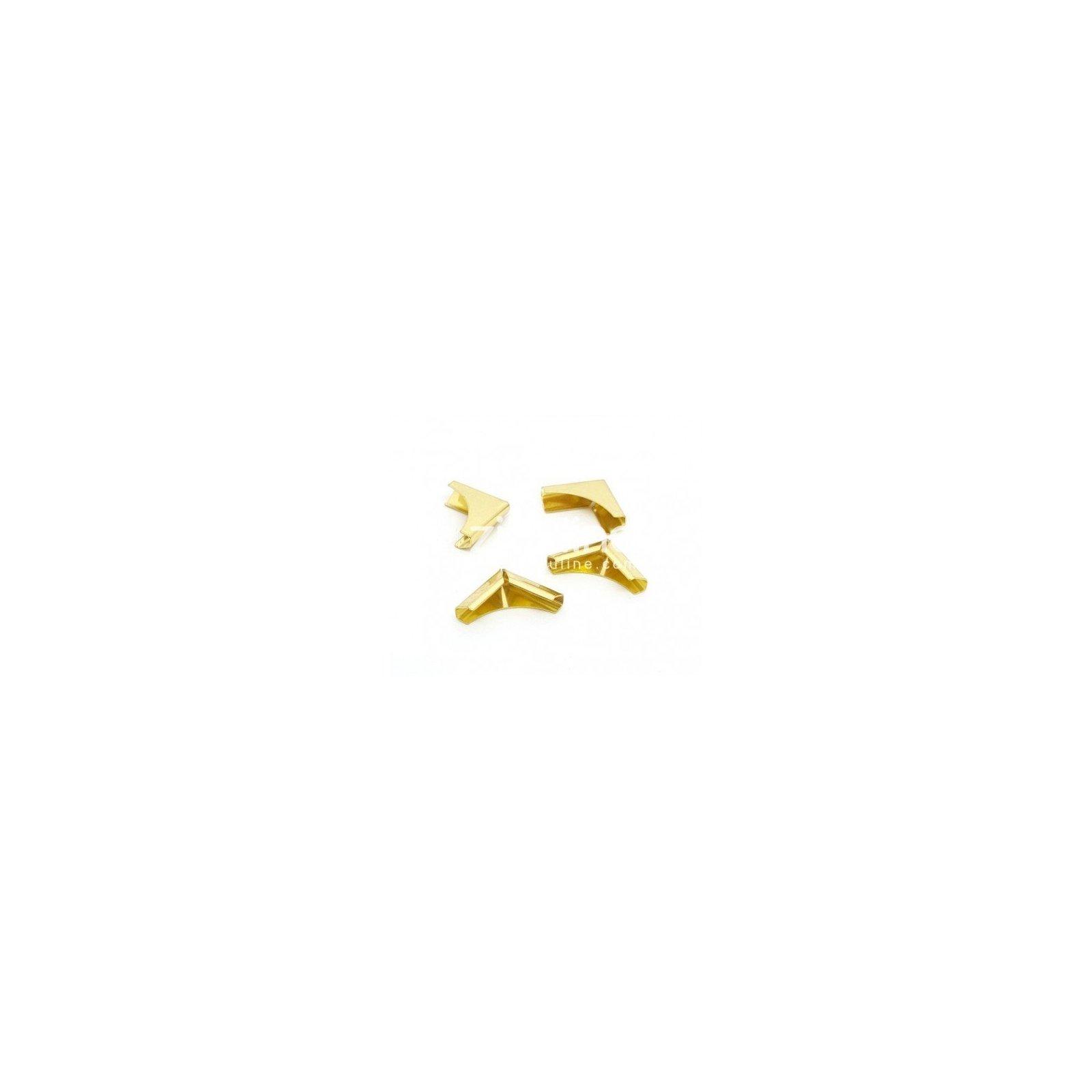 Coins en métal dorés - Zibuline